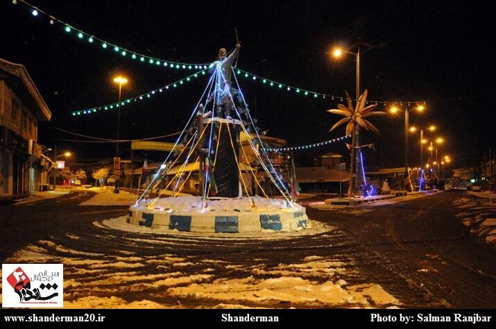 مجسمه آرش کمانگیر در یک شب برفی